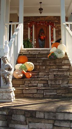 Here are some great ideas for decorating your front porch area as we are coming into Fall. Halloween is right around the corner and there are many ways to decorate your front door area with wreaths, pumpkins and plants. White Pumpkins, Fall Pumpkins, Pumpkin Ornament, Farmhouse Front Porches, Porch Decorating, Decorating Ideas, Holiday Decorating, Outdoor Doors, Fall Halloween