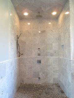 Complete Shower Remodel with Arabescato Carrara Marble Tile and Pebbles