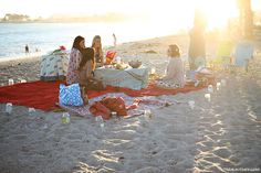 Beach picnic with votives.