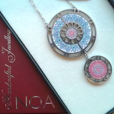NOA Jewellery stainless steel & decorated walnut two circles in pinks and blues boxed. www.noajewellery.com