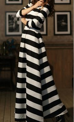 A classy 3/4 sleeve modest maxi dress with black and white bold stripes and high neckline available in M-XL