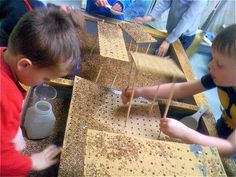 Create levels in the sensory table with peg boards