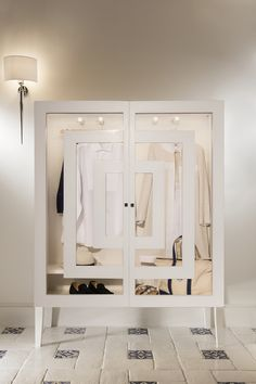 Capritouch Suites at Capri Palace Hotel & Spa -  Anacapri, Italy. A Capritouch outfit, placed inside a wardrobe created ad hoc, is proposed to the guests of this Suite