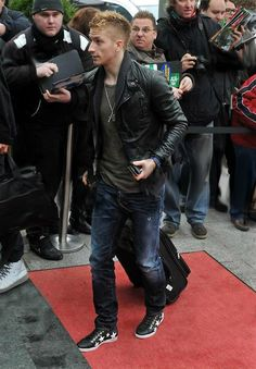 Marco Reus wearing a leather jacket, jeans and starstruck Converse