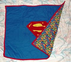 It's SuperBaby - crib sized superman baby blanket