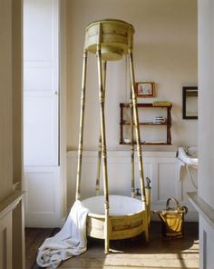 The old fashioned metal free-standing shower at Erddig. The water was discharged from the top and collected in the base. A copper water can stands below the sink and bathroom shelves.©National Trust Images/Andreas von Einsiedel.