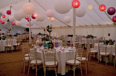 White and coloured paper lanterns and amazing coloured glass goblets make a funky Marquee Interior Design {theweddinghunter}