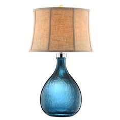 Light filters beautifully through the peacock blue glass vase base on this Stein World Ariga Table Lamp . A natural linen empire shade and ball finial. Brighton, Blue Glass Vase, Glass Lamps, Colored Glass, Lamp Shade Store, Elk Lighting, Beach Lighting, Coastal Lighting, Lighting Ideas