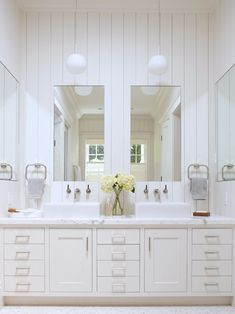 Cottage meets transitional bath.  Vertical planks, mirrors on each wall