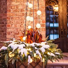 A mix of bistro and mini lights brightens up any winter arrangement on your front porch! http://www.bhg.com/christmas/outdoor-decorations/outdoor-holiday-decorating-ideas/?socsrc=bhgpin120714snowglobeplanter&page=13