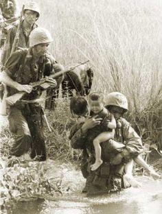 US soldiers with Vietnamese children, Vietnam