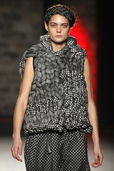 Hand woven combined vest. Love the idea of using thick fabric and yarn together