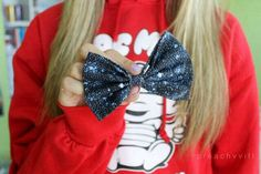 The bow is cute but WHERE CAN I GET THAT SWEATSHIRT