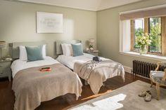 Each of the twin bedrooms enjoy garden views