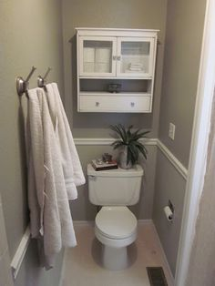 In each bath that has seperate water closet...small water closet built-in CABINET above toilet, to match that bath's cabinetry. NOT SEE THRU DOOR, NO GLASS FRONTS! Do this in every water closet (kristi, Brad's, and guest room water closet). But maybe NOT in Emerson or Grant's, since not seperate w.c., and that'll look bad.