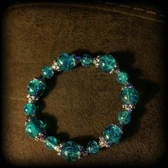 Check out this item in my Etsy shop https://www.etsy.com/listing/263845457/blue-and-silver-beaded-bracelet