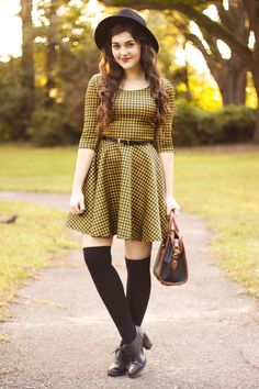 """Houndstooth""  Personally, I would do dark brown tights instead of high socks :)"