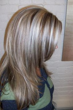 Hair streaked with silver, highlights & dark low lights.