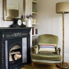 Velvet armchair with antique fireplace | Small living room ideas | Living room | Housetohome.co.uk