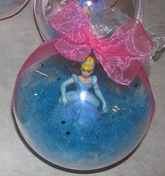 DIY Disney Christmas Ornaments (but could work with any small figurine or object)-use plastic ornament balls, glue object in place, add filler, glue ornament halves together, add ribbon and trim! Love for favorite character each year Noel Christmas, Christmas Projects, Holiday Crafts, Holiday Fun, Frozen Christmas, Christmas Globes, Holiday Store, Mickey Christmas, Christmas Ideas