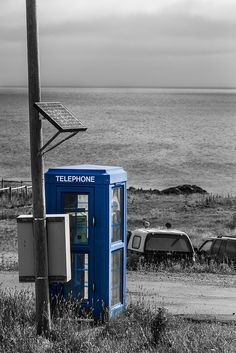 St Pierre and Miquelon, interesting contrast - green phone in blue cabin, against black and white background