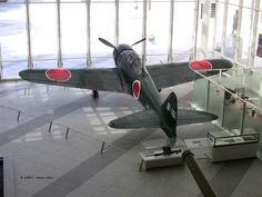 A6M Zero fighter Model 52 exposed at the Yushukan Museum, Tokyo, Japan, September 7, 2009; Note p Cannon Type 99 20-mm exposed in the window
