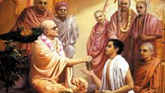 Prabhupada (then Abhay Caran De) receiving his initiation beads from his spiritual master, Bhaktisiddhanta Sarasvati Thakura in 1933.