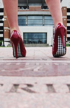 Red High heels with a black and white Houndstooth sole. #redandblack #red #redshoes