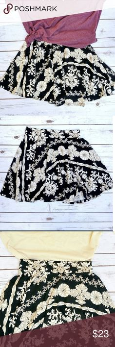 Black & Cream Floral Print Mini Circle Skirt Your favorite skirt has arrived. You're welcome. The cream color in this skirt gives off total pinot grigio, moscato, champagne vibes and the black just means it will match anything!  This is a flowy print skirt. It is unlined. It just has that one layer. There is an elastic waistband for a little stretch. Small is about sizes 0-3, Medium=3-5, Large=5-7 Skirts Mini