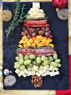 christmas snacks Tis the season for festive cheese boards like this Christmas Tree Charcuterie Board featuring salami, capocollo, grapes, nuts and a variety of cheeses. Christmas Party Snacks, Christmas Brunch, Xmas Food, Snacks Für Party, Christmas Cooking, Holiday Dinner, Party Treats, Christmas Tree Food, Christmas Desserts