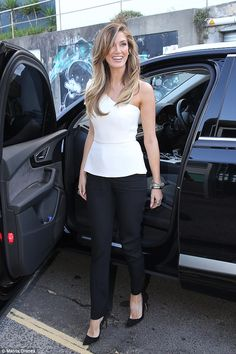 Leggy lady: Delta Goodrem put on a leggy display in stylish trousers as she dined out in Sydney's Bondi with fellow Voice Australia judgesJessie J, brothers Joel and Benji Madden and Ronan Keating on Sunday