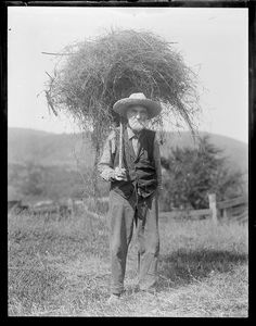 Old farmer with pitch fork full of hay, 1930. I would like to drink a cup of coffee with this man.