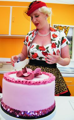 Burlesque baker Charlotte White (www.restorationcake.co.uk) in The Kenwood Kitchen Theatre at Goodwood Revival 2015 ©Come Step Back In Time.