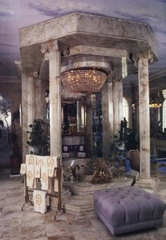 Bathing in Style - With its own private chandelier and marble columns, it's hard to imagine a more opulent bath tub than this one from Liberace's Las Vegas abode.