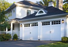 Garage doors. COACHMAN® COLLECTION authentic looking insulated steel and composite carriage house garage doors. Clopay.
