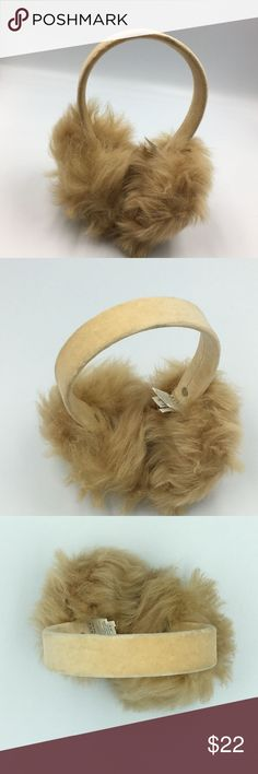 Banana Republic Fur Earmuffs with Headband The fabric on the headband is 100% cotton. The fur is shearling wool. Very good condition.  Unisex.  Make a reasonable offer and I'll either counter, accept or decline. No trades.  Please check out the rest of my closet, I have various other brands. Banana Republic Accessories Hair Accessories