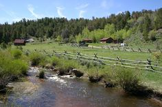 To stay at a ranch and go horse back riding and fly fishing in Wyoming.