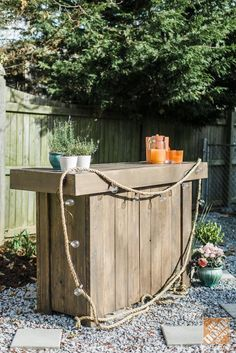 DIY Bar and String Lights Intertwined with Rope: Clever outdoor decorating ideas by Caitlin Moran of Style Within Reach. On The Home Depot Blog.
