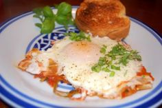 Uova in Brodetto: Eggs in Tomato Sauce - Newlyweds I put this under breakfast, but it would be good for any meal Paleo Breakfast, Breakfast Time, Breakfast Recipes, Breakfast Ideas, Egg Recipes, Cooking Recipes, Tomato Sauce Recipe, Dinner On A Budget, Food Hacks