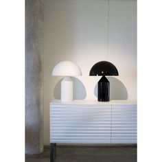 Black & White. #Atollo lamp by #Magistretti and furniture #Horm by @kariminc