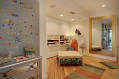 The hall, Stainless steel panel with magnetic letters to leave messages, a storage ottoman houses the Beach towels and cabinets house the games, and beach toys