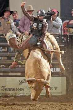 Zack Brown rides Straight Jacket in Professional Bull Riders action in Billings Saturday April 06, 2013.
