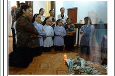 This photo was taken in Vietnam. The statute of Blessed Virgin Mary was smashed by soldiers. All present were very upset. They knelt & prayed. They did not know that our Mother Mary appeared & was praying with them. This is a miracle when a camera could pick up what bare eyes could not.