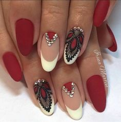 White and maroon nail art design. A wonderful combination of french tips as well as lace designs that's combining the white, black and maroon nail polish making the overall design look more elegant.