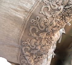 linen pillowcase with embroidered detail by Arte