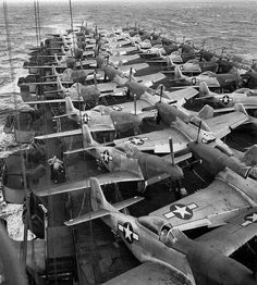 North American P-51 Mustang Pursuit Fighters being transported to the Theaters of Battle by sea.
