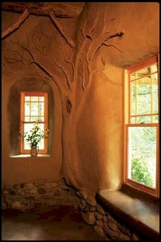 Earthen accents can make a dramatic statement, like this stately tree designed by Deanne Bednar. Photo by Catherine Wanek via Mother Earth News.
