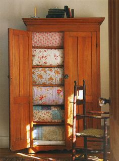 patchwork quilts in a gigantic, beautifully crafted armoire. Old Quilts, Vintage Quilts, Antique Quilts, Baby Quilts, Table Farmhouse, Fresh Farmhouse, Vintage Farmhouse, Farmhouse Style, Quilt Storage