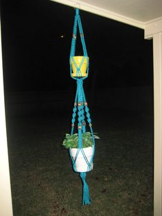 """Thank you for visiting my store. I enjoy creating handmade items to be used for personal use or as gift giving. I take pride in my creations and make them to the highest quality and if for any reason I feel it is not up to my standards I will NOT list the item.    Handmade Double Macrame Plant Hanger Turquoise 66"""" with Wood Beads Handmade in the USA with 6mm Polypropylene Macrame cord which is colorfast, washable and formulated with UV stabilizers. They are great for indoors or outdoors…"""