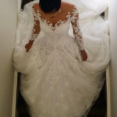 This pretty long sleeve lace wedding dress was originally made by a haute couture designer. Many brides can not afford the cost. So when a bride loves a dress out of her budget we can help by making a less expensive #replica of the dress that looks similar but cost less. Get pricing on custom wedding dresses & replicas at www.dariuscordell.com